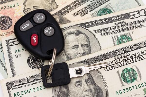 car keys on top of money