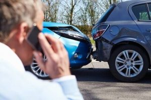 driver-making-phone-call-after-accident_640_preview